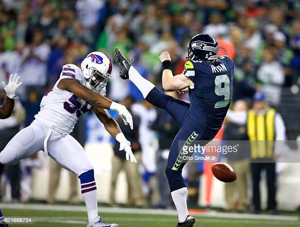 Linebacker Jerry Hughes of the Buffalo Bills blocks the punt of Jon Ryan of the Seattle Seahawks at CenturyLink Field on November 7 2016 in Seattle...