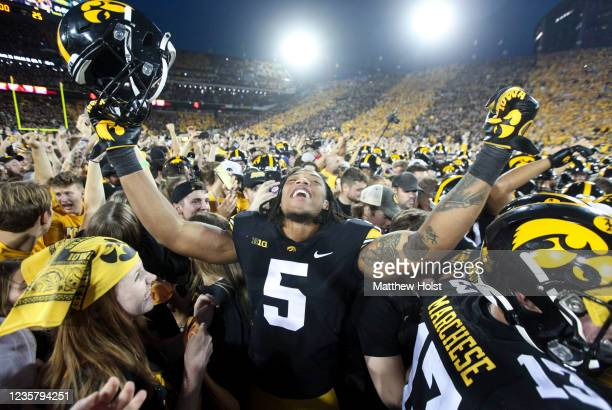 Linebacker Jestin Jacobs of the Iowa Hawkeyes celebrates with fans after the match-up against the Penn State Nittany Lions at Kinnick Stadium on...
