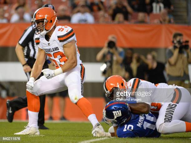 Linebacker Joe Schobert of the Cleveland Browns celebrates after sacking quarterback Eli Manning of the New York Giants in the first quarter of a...