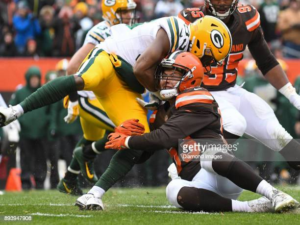 Linebacker Joe Schobert of the Cleveland Browns tackles running back Aaron Jones of the Green Bay Packers in the second quarter of a game on December...