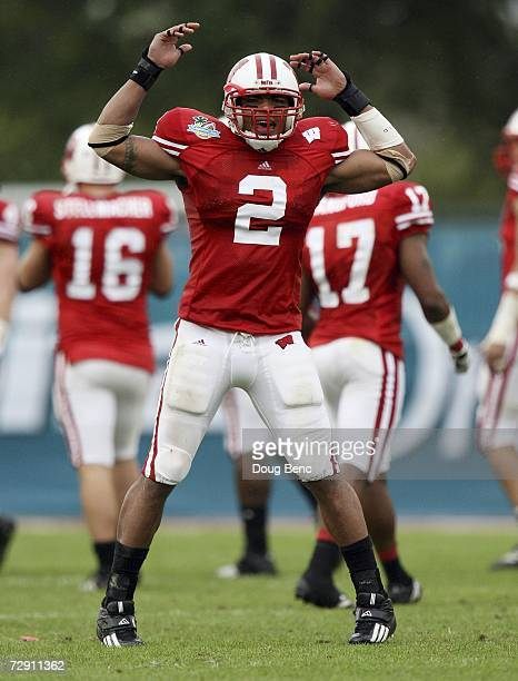 Linebacker Jonathan Casillas of the Wisconsin Badgers celebrates a play in the third quarter against the Arkansas Razorbacks in the Capitol One Bowl...