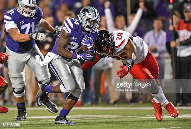 Linebacker Jordyn Brooks of the Texas Tech Red Raiders moves in to tackle running back Charles Jones of the Kansas State Wildcats during the second...