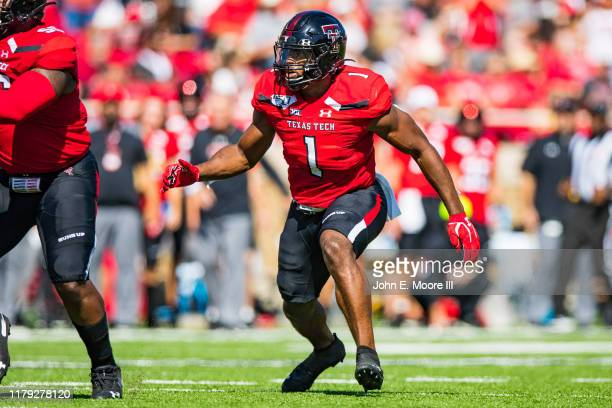 Linebacker Jordyn Brooks of the Texas Tech Red Raiders rushes into the backfield during the first half of the college football game against the...