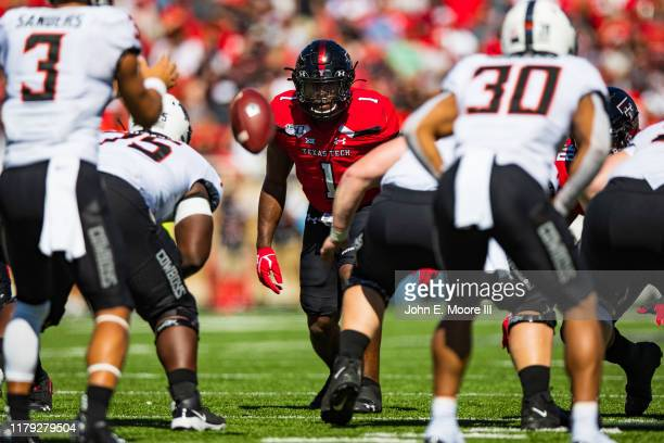 Linebacker Jordyn Brooks of the Texas Tech Red Raiders watches the snap during the first half of the college football game against the Oklahoma State...