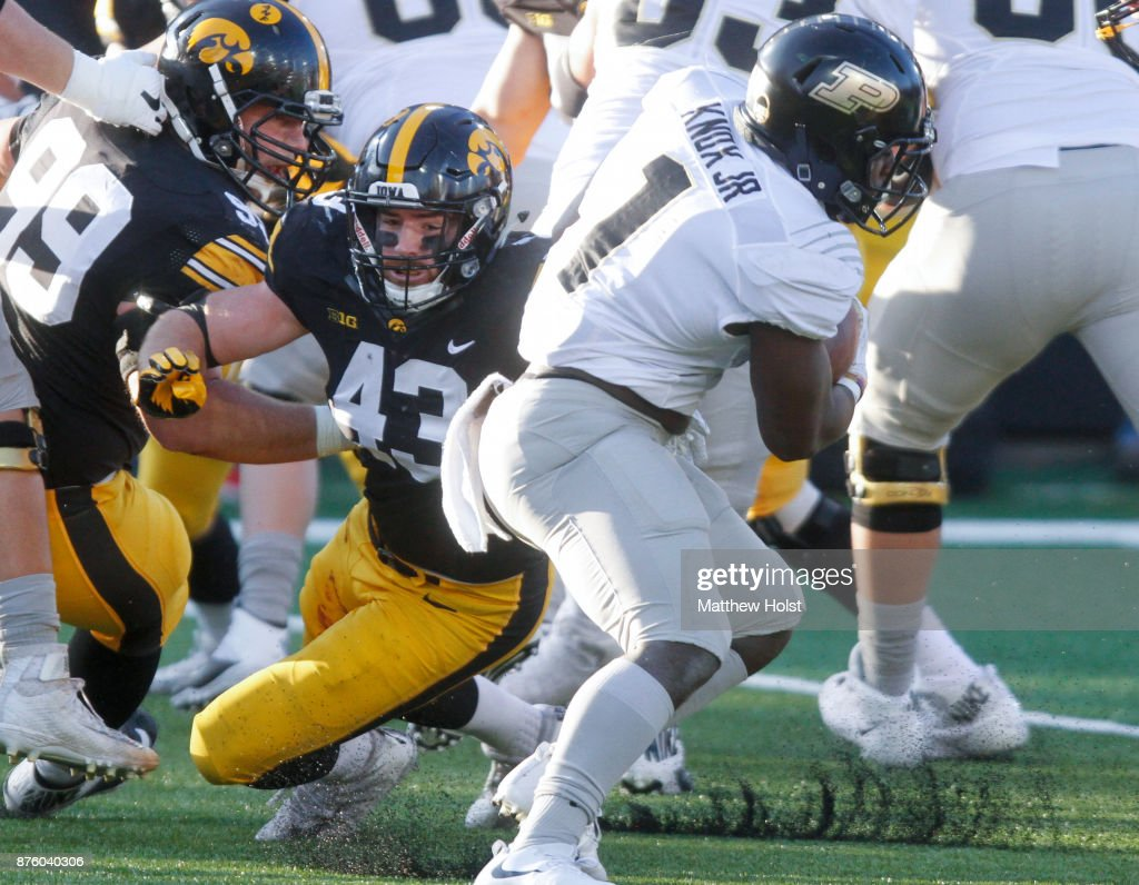 Linebacker Josey Jewell #43 of the Iowa Hawkeyes makes a tackle during the second quarter on running back D.J. Knox #1 of the Purdue Boilermakers on November 18, 2017 at Kinnick Stadium in Iowa City, Iowa.