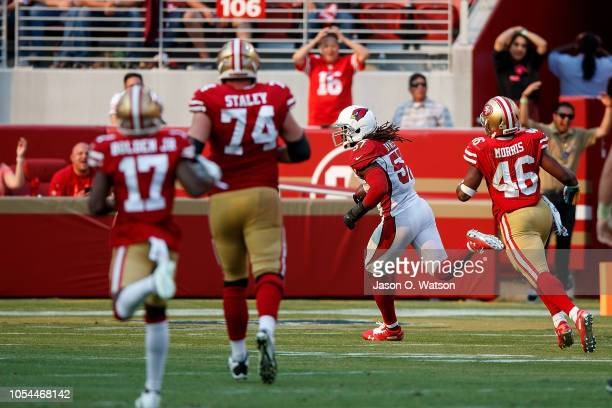 Linebacker Josh Bynes of the Arizona Cardinals returns a fumble for a touchdown against the San Francisco 49ers during the fourth quarter at Levi's...