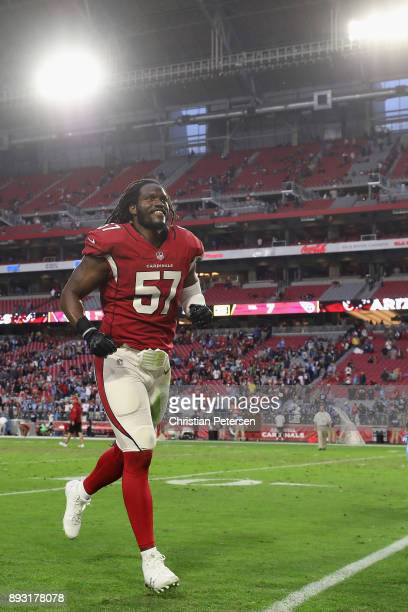 Linebacker Josh Bynes of the Arizona Cardinals runs off the field following the NFL game against the Tennessee Titans at the University of Phoenix...