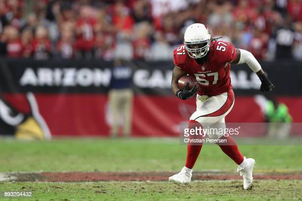 Linebacker Josh Bynes of the Arizona Cardinals rushes the football against the Tennessee Titans during the second half of the NFL game at the...