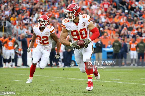 Linebacker Josh Mauga of the Kansas City Chiefs intercepts a pass by quarterback Peyton Manning of the Denver Broncos in the second quarter at Sports...