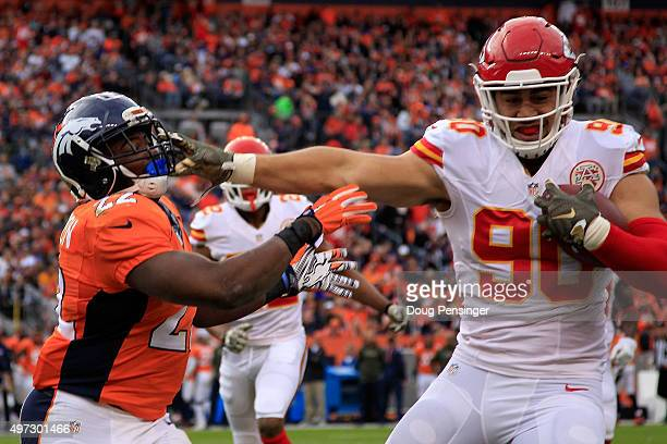 Linebacker Josh Mauga of the Kansas City Chiefs intercepts a pass by quarterback Peyton Manning of the Denver Broncos and is driven out of bounds by...