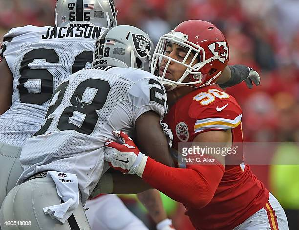 Linebacker Josh Mauga of the Kansas City Chiefs tackles running back Latavius Murray of the Oakland Raiders during the first half on December 14 2014...