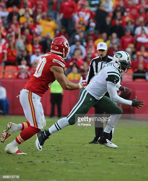 Linebacker Josh Mauga of the Kasas City Chiefs pressures Quarterback Michael Vick of the New York Jets at Arrowhead Stadium on November 2 2014 in...