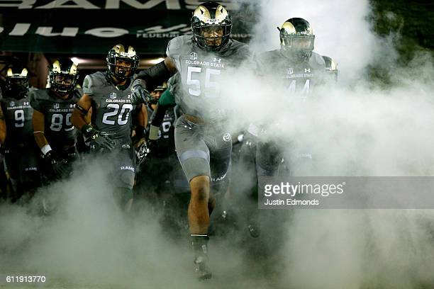 Linebacker Josh Watson of the Colorado State Rams leads the team onto the field before taking on the Wyoming Cowboys at Sonny Lubick Field at Hughes...