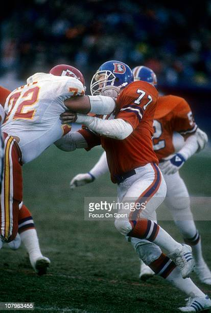 Linebacker Karl Mecklenberg of the Denver Broncos is blocked by Dave Lutz of the Kansas City Chiefs during an NFL football game at Mile High Stadium...