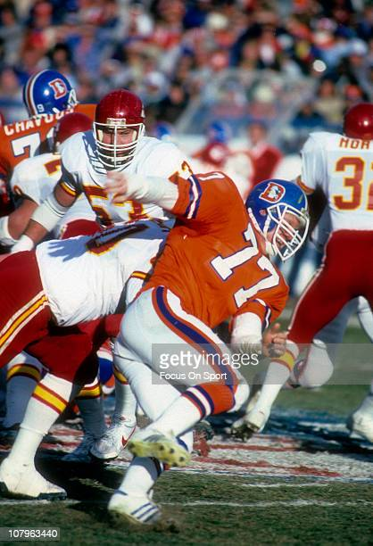 Linebacker Karl Mecklenberg of the Denver Broncos pursues the play against the Kansas City Chiefs during an NFL football game at Mile High Stadium...