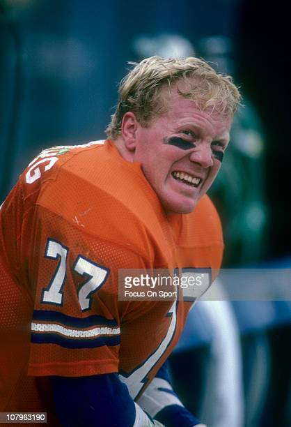 Linebacker Karl Mecklenberg of the Denver Broncos watches the action from the sidelines during an NFL football game at Mile High Stadium circa 1986...