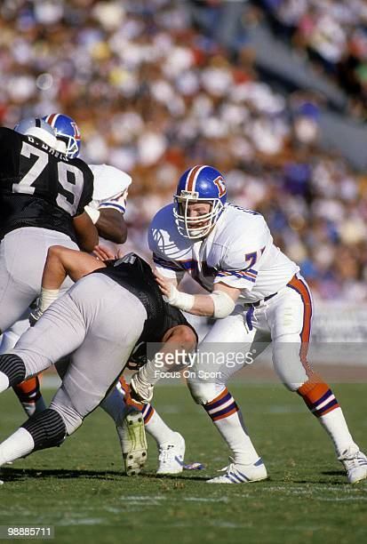 Linebacker Karl Mecklenburg of the Denver Broncos in action circa 1990 against the Los Angeles Raiders during an NFL football game at the Los Angeles...