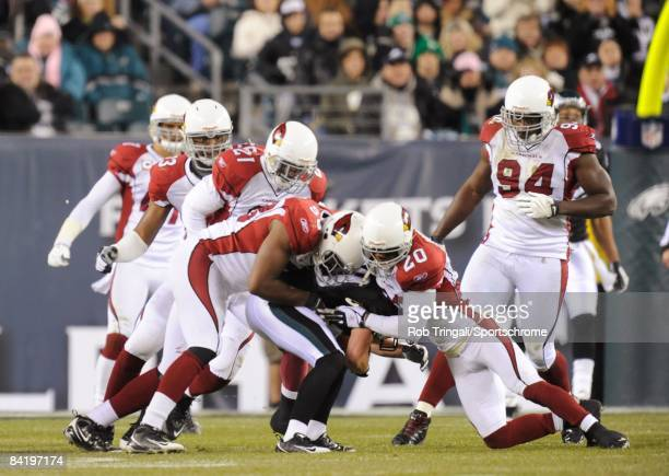 Linebacker Karlos Dansby and Defensive back Ralph Brown of the Arizona Cardinals tackle - against the Philadelphia Eagles at Lincoln Financial Field...