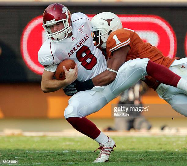 Linebacker Keenan Robinson of the Texas Longhorns sacks quarterback Tyler Wilson of the Arkansas Razorbacks in the fourth quarter on September 27...