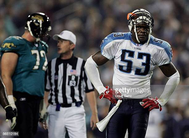 Linebacker Keith Bulluck of the Tennessee Titans reacts as referee Bill Carollo explains a penalty against the Titans to offensive lineman Mike...