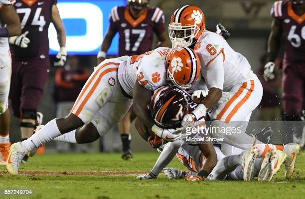 Linebacker Kendall Joseph and linebacker Dorian O'Daniel of the Clemson Tigers combine to tackle running back Deshawn McClease of the Virginia Tech...