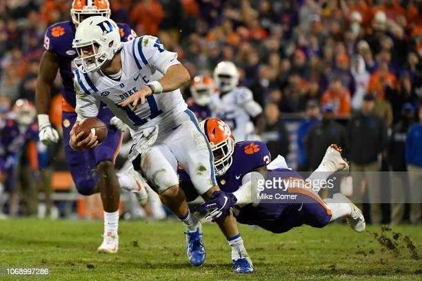 Linebacker Kendall Joseph of the Clemson Tigers hangs on to quarterback Daniel Jones of the Duke Blue Devils during their football game at Clemson...