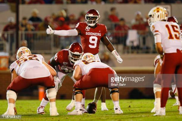 Linebacker Kenneth Murray and defensive lineman Neville Gallimore of the Oklahoma Sooners prepare for a snap against the Iowa State Cyclones in the...