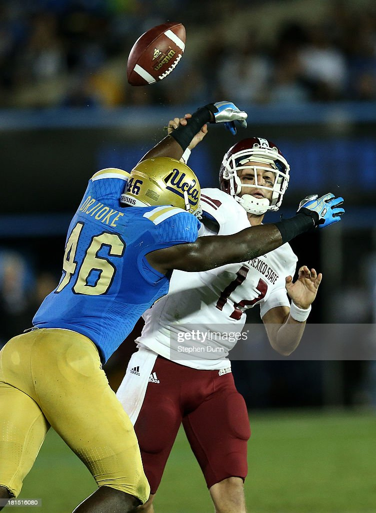 Linebacker Kenny Orijoke #46 of the UCLA Bruins breaks up a pass by quarterback Andrew McDonald #12 of the New Mexico State Aggies at the Rose Bowl on September 21, 2013 in Pasadena, California. UCLA won 59-13.