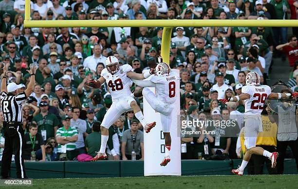 Linebacker Kevin Anderson of the Stanford Cardinal celebrates a interception returned for a touchdown against the Michigan State Spartans in the...
