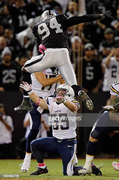 Linebacker Kevin Burnett of the Oakland Raiders hurdles running back Danny Woodhead of the San Diego Chargers to put pressure on quarterback Philip...