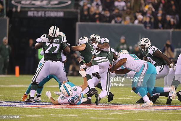 Linebacker Kiko Alonso of the Miami Dolphins makes a stop against the New York Jets at MetLife Stadium on December 17, 2016 in East Rutherford, New...