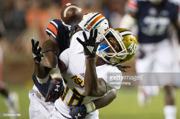 Linebacker KJ Britt of the Auburn Tigers blocks a pass intended for wide receiver Jamir Hannah of the Alabama State Hornets during the third quarter...