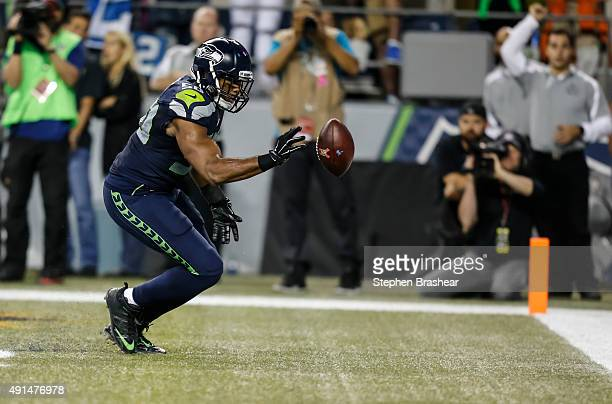 Linebacker KJ Wright of the Seattle Seahawks bats a loose ball out of the back of the end zone during the second half of a football game at...