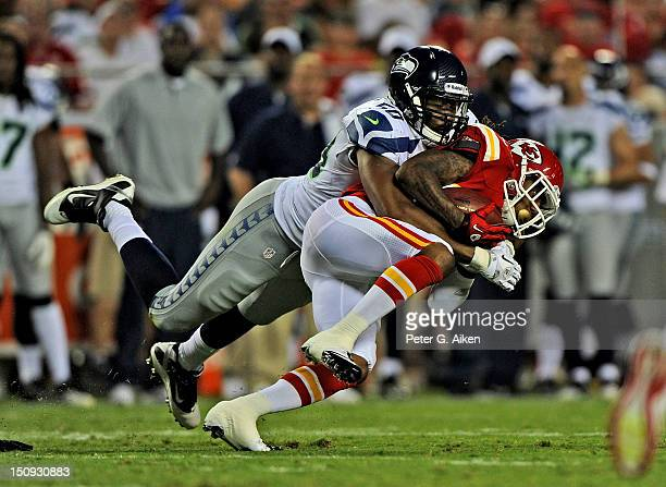 Linebacker KJ Wright of the Seattle Seahawks tackles wider receiver Dexter McCluster of the Kansas City Chiefs during the second half of a preseason...