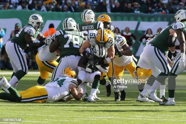 Linebacker Kyler Fackrell and Defensive Lineman Dean Lowry of the Green Bay Packers make a stop against the New York Jets at MetLife Stadium on...