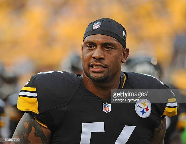 Linebacker LaMarr Woodley of the Pittsburgh Steelers looks on from the sideline during a preseason game against the New York Giants at Heinz Field on...
