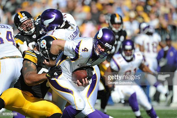 Linebacker LaMarr Woodley of the Pittsburgh Steelers sacks quarterback Brett Favre of the Minnesota Vikings during a game at Heinz Field on October...