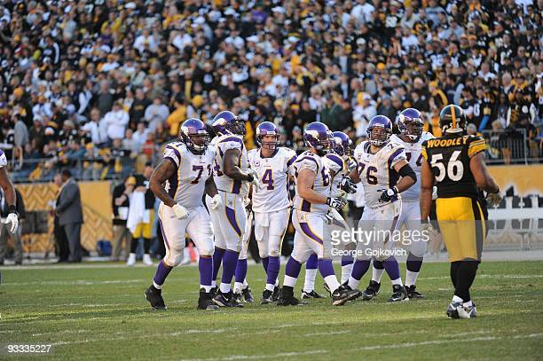 Linebacker LaMarr Woodley of the Pittsburgh Steelers watches as quarterback Brett Favre and offensive linemen Phil Loadholt Anthony Herrera John...