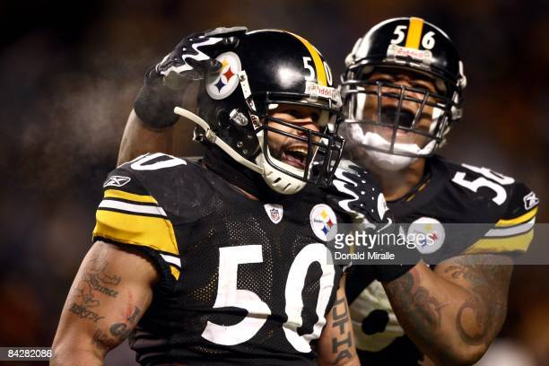 Linebacker Larry Foote of the Pittsburgh Steelers is congratulated by teammate LaMarr Woodley en route to his team's 3524 victory over the San Diego...