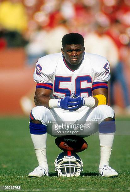 Linebacker Lawrence Taylor of the New York Giants in this portrait sitting on his helmet December 3, 1990 before an NFL football game against the San...