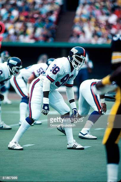 Linebacker Lawrence Taylor of the New York Giants waits for the snap in a 1981 preseason game against the Pittsburgh Steelers