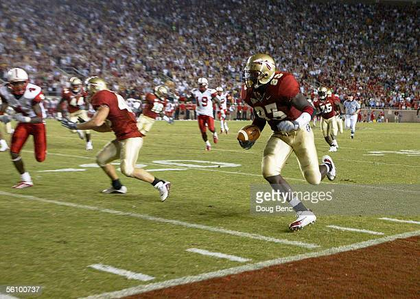 Linebacker Lawrence Timmons of the Florida State Seminoles returns the second consecutive blocked punt in the fourth quarter against the North...