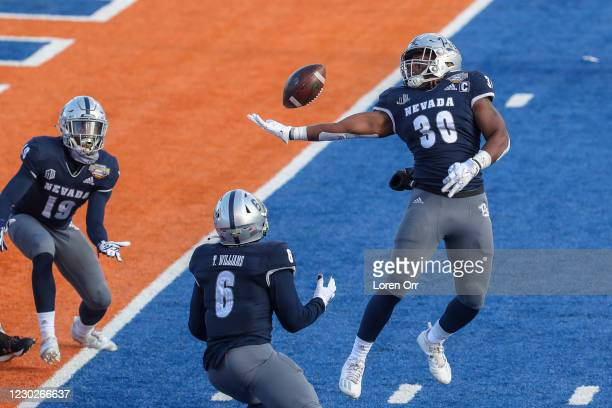 Linebacker Lawson Hall of the Nevada Wolf Pack attempts to intercept a tipped pass during first half action against the Tulane Green Wave at the...