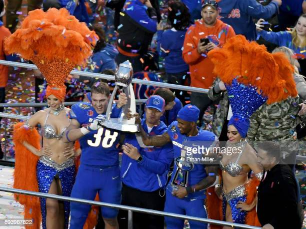 Linebacker Leighton Vander Esch head coach Bryan Harsin and wide receiver Cedrick Wilson of the Boise State Broncos celebrate after the team defeated...