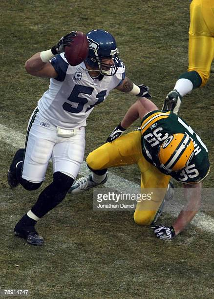 Linebacker Lofa Tatupu of the Seattle Seahawks recovers a fumble by Ryan Grant of the Green Bay Packers on the first play from scrimmage setting up a...