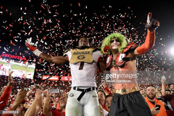 Linebacker Lorenzo Carter of the Georgia Bulldogs celebrates with a fan after winning the 2018 College Football Playoff Semifinal at the Rose Bowl...