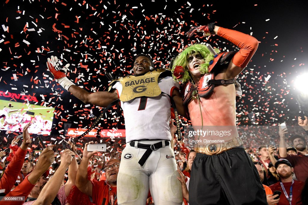 Linebacker Lorenzo Carter #7 of the Georgia Bulldogs celebrates with a fan after winning the 2018 College Football Playoff Semifinal at the Rose Bowl Game presented by Northwestern Mutual against the Oklahoma Sooners 54-48 at the Rose Bowl on January 1, 2018 in Pasadena, California.