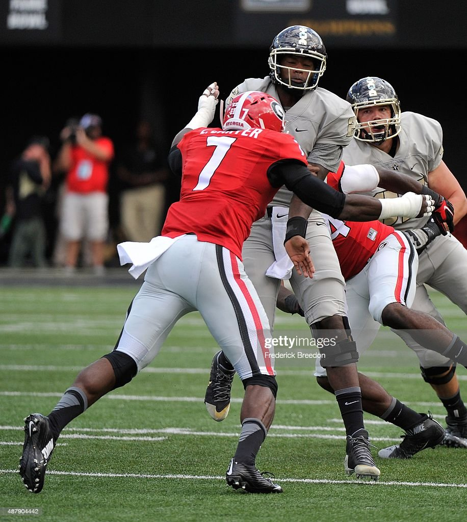 Linebacker Lorenzo Carter of the Georgia Bulldogs hits quarterback Johnny McCrary #2 after passing the ball during the first half at Vanderbilt Stadium on September 12, 2015 in Nashville, Tennessee. Carter was ejected from the game for this play after being called for targetting.