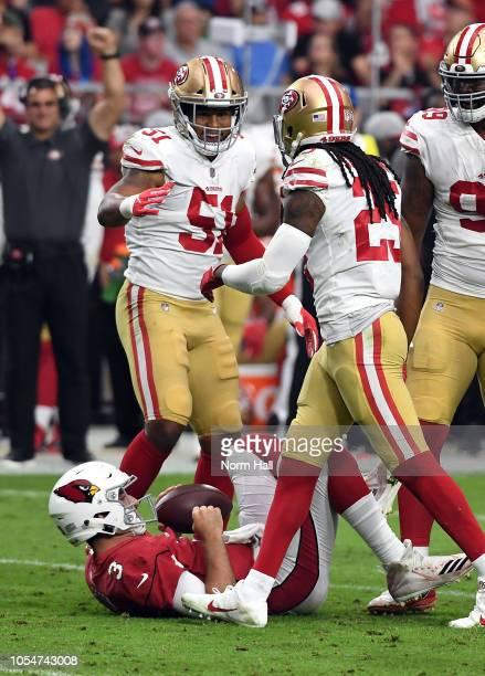 Linebacker Malcolm Smith reacts with cornerback Richard Sherman of the San Francisco 49ers after tackling quarterback Josh Rosen of the Arizona...
