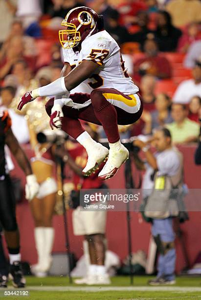 Linebacker Marcus Washington of the Washington Redskins leaps after making a tackle against the Cincinnati Bengals during the first half of their...